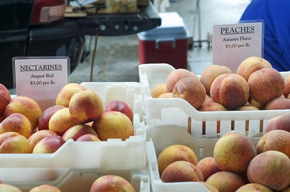 Summer's last gasp: Hamada Farms peaches at Ferry Plaza. - SEAN TIMBERLAKE