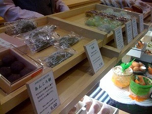 Sweets are displayed in bamboo cases. - G. MIGUEL