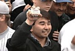 Take Me Out: Patrick Hayashi showing off - the prize.