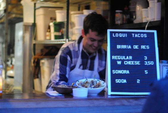 Tartine baker Cameron Wallace behind the counter at his twice-weekly taco pop-up, Loqui. - LIV COMBE
