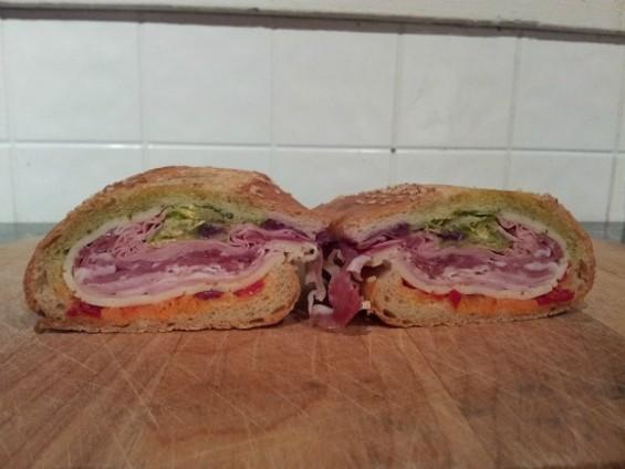 The $9 Half Italian Combo (here halved again): mortadella, salami, prosciutto cott, provolone, lettuce, onion, tomato, dressing and hots. - PETE KANE