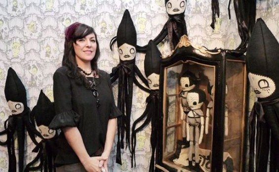 The artist with some of her work