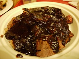 The beef brisket: Bland and drenched. - G. MIGUEL