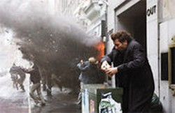 JAAP  BUITENDIJK - The Breakup: Disillusioned bureaucrat Theo (Clive Owen) ducks a bomb blast.
