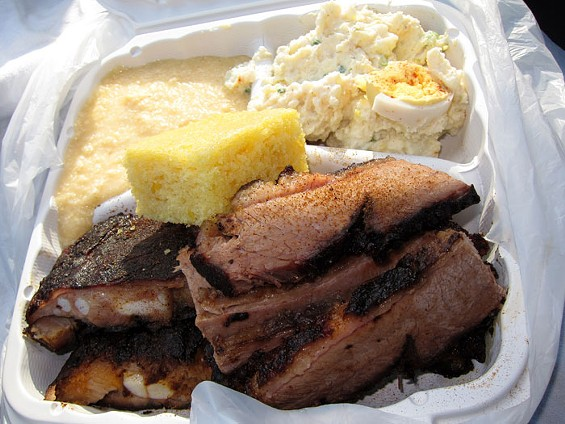 The brisket and rib combo with two sides and cornbread, $14. - LUIS CHONG