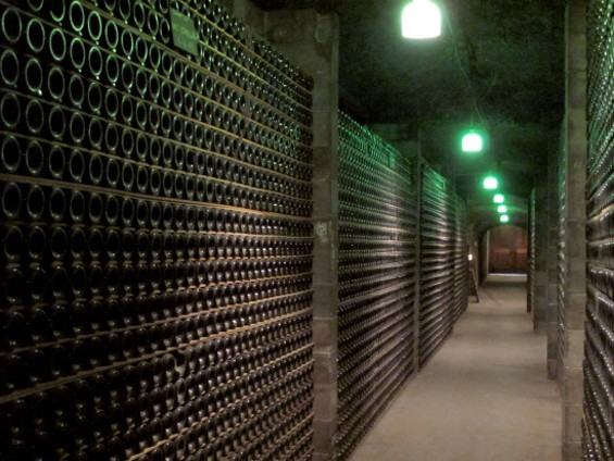 The caves at Schramsberg with bottles of sparkling wine aging - LOU BUSTAMANTE