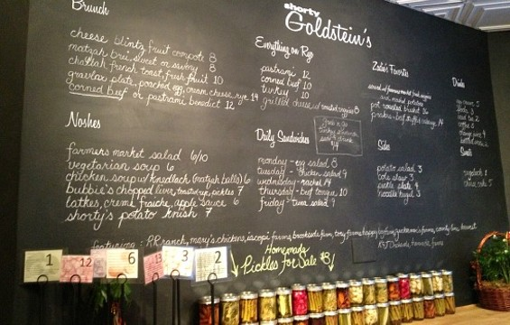 The chalkboard menu and house-made pickles at Shorty Goldstein's. - ANNA ROTH