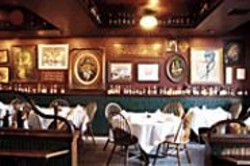 ANTHONY  PIDGEON - The Classics: Izzy's is designed to look like - the old restaurants pictured in photos on the - walls.