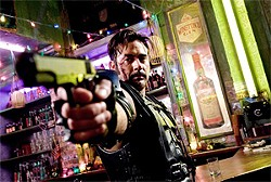 The Comedian (Jeffrey Dean Morgan) is out to kill the Watchmen.