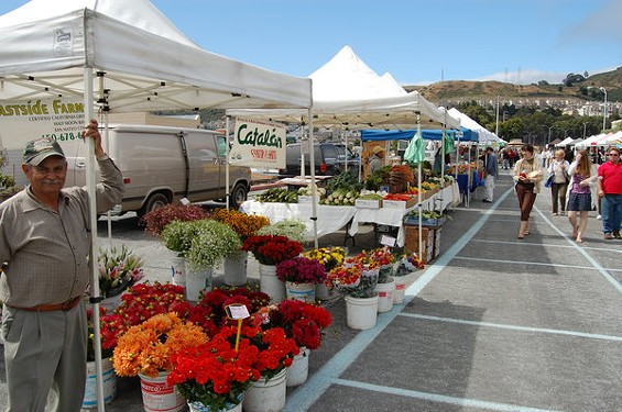 The Cow Palace Farmers' Market takes place Saturdays through mid-October. - URBAN VILLAGE
