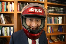 MIKE KOOZMIN - The dean, who also rides motorcycles, seems most at ease when he's in motion.