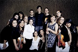 The Dodos, surrounded by Magik*Magik Orchestra.