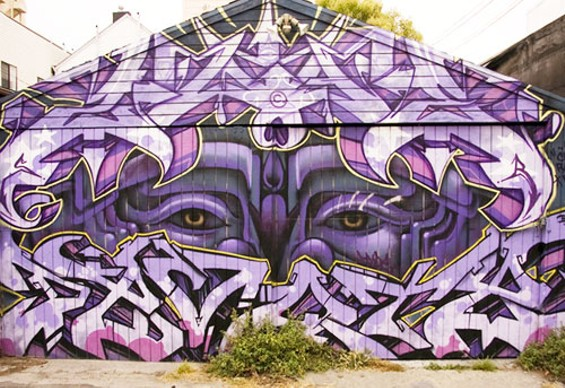 The first of many eye-catching garage doors on Lilac Alley. - JOSEPH SCHELL