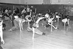 BRANDON  FERNANDEZ - The gleeful, uncoordinated break-dancing debut of the - Sisterz of the Underground's workshop students.