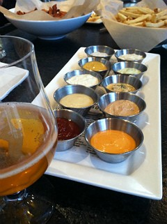 The glorious array of dipping sauces for frites. - JASON HENRY