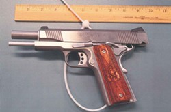 The gun worn by a man in the OccupySF camp