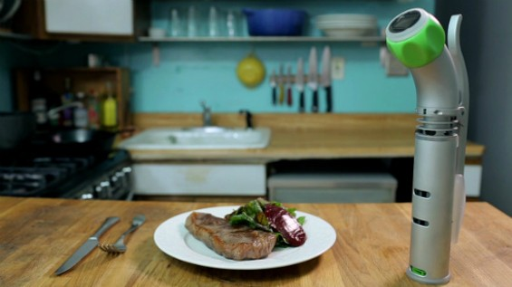The hand-held Nomiku with a perfect sous vide steak. - NOMIKU
