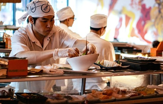 The new bill would change the requirement for sushi chefs to wear gloves when they work. - FLICKR/BARSEN