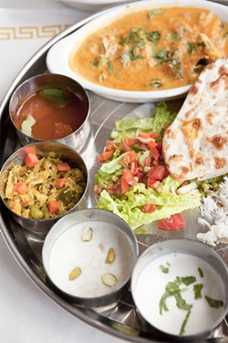 KIMBERLY SANDIE - The pleasure of eating a thali is never knowing exactly where to focus.