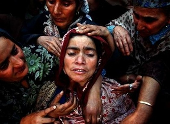 """""""The Poetry of Kashmir"""" by Ami Vitale (USA). Relatives of Naz Banu, who was killed during an attack on leading politician Sakina Yatoo, mourn during her funeral in the northern Kashmir town of Mirhama. At least 11 people were killed in the attack alone."""
