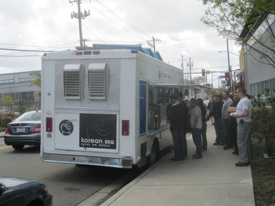 The Seoul on Wheels truck attracts a lunch crowd on Emeryville's Hollis Street. - CARLOS A./YELP