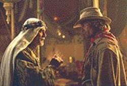 RICHARD  CARTWRIGHT - The Sheik and the Cowboy: Omar Sharif - and Viggo Mortensen ham it up manfully.