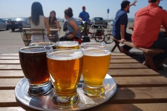 The tasting flight at Faction Brewing - FERRON SALNIKER