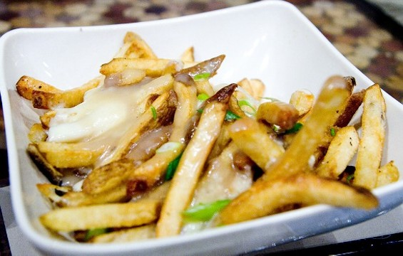 The too-salty-to-eat poutine at Jamber. - THE DAPPER DINER