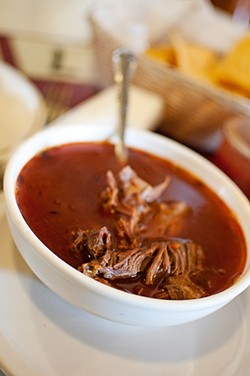GIL RIEGO JR. - The weekends-only lamb birria at Gallardos glows like a beacon.