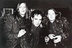 This is an old photo (the guy between Nash Kato, left, - and King Roeser is no longer in the band), but look - how drunk they all look! And the matching jackets! We - had to run it.