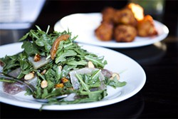 JEN SISKA - This salad blends the bite of arugula with the sweetness of apricots.