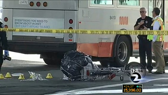 "This television image indicates the bus that killed a 78-year-old man is missing an ""S-1 Gard"" -- a device which prevents people from being run over by a bus' back-right tire - KTVU"