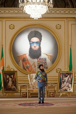 This time, Sacha Baron Cohen is in on the joke, but the chair isn't.
