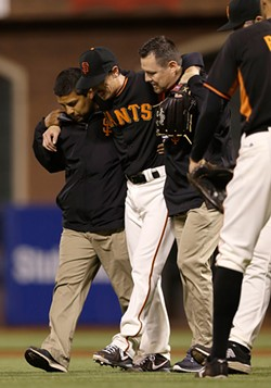 AP PHOTO/JEFF CHIU - Tim Lincecum takes one to the knee. The rest is the stuff of narrative.