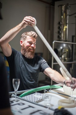 ERIC LAWSON - Tim Welch, who bulldozed wreckage from hurricanes and pulled crude oil out of the Gulf of Mexico, is much happier distilling whiskey.