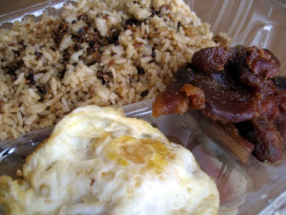 Tocino, egg, and extra-garlicky garlic rice ($5.95). - JONATHAN KAUFFMAN