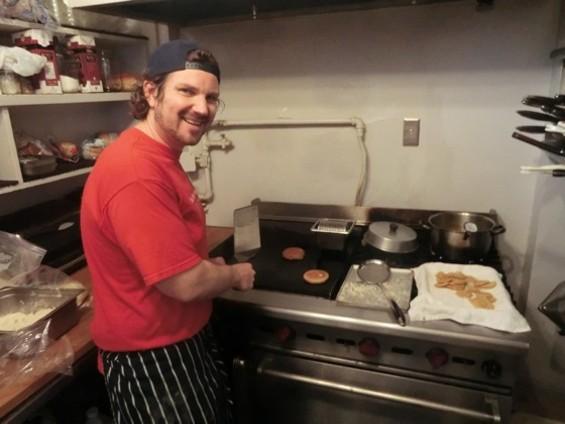Tom Pizzica mans the grill at Clooney's. - ALEX HOCHMAN
