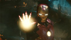 "Tony Stark (Robert Downey Jr.) is now garishly ""out"" as Iron Man."