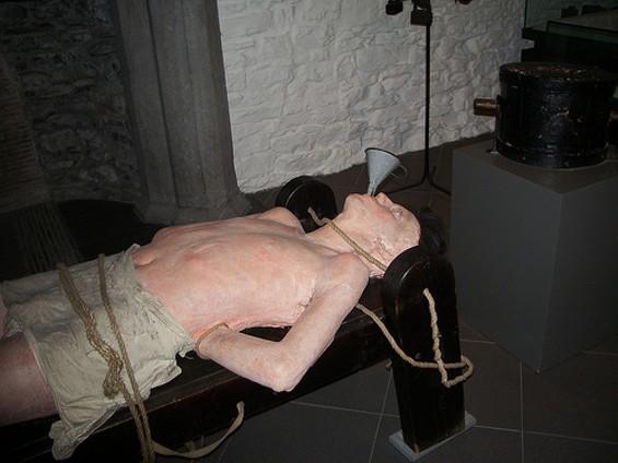 Torture? Or graduation night beer-funneling?