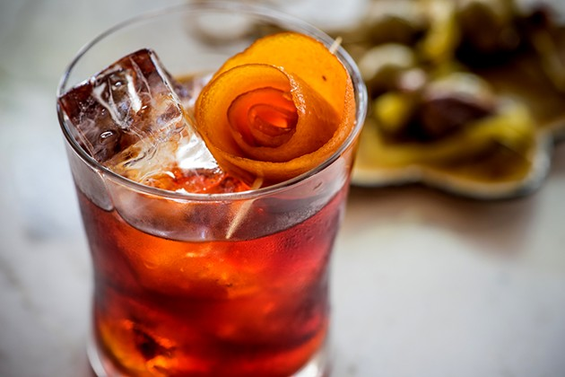 Pup-Groni from Aatxe made with Campari, Aperol, Big Gin house-infused with saffron and orange peel, and Alessio Torino. - WES ROWE