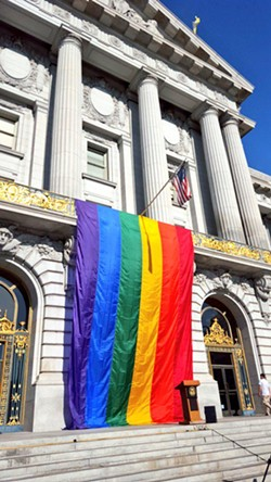 A rainbow flag was unfurled at San Francisco City Hall following the decision - JOE FITZGERALD RODRIGUEZ