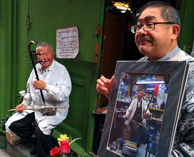 Frank Jang (right) and the talented Jun Yu, a barber and erhu player whose talents got him a cameo in the Will Smith movie The Pursuit of Happyness. - PHOTO BY JESSICA FENDER