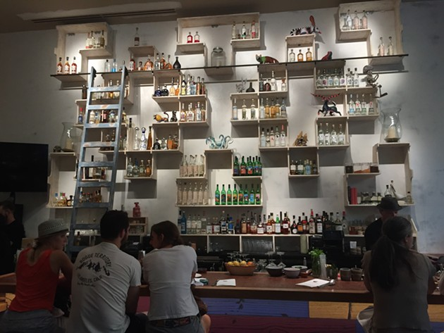 Calavera's bar serves some damn fine cocktails and holds about 300 bottles — so far — of mezcal and tequila. - ALIX WALL