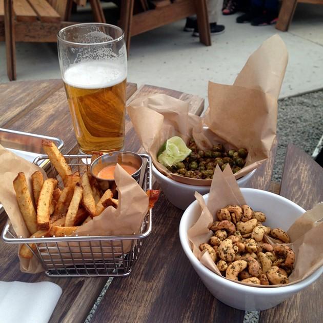 Togarashi fries with Sriracha mayo, Hella Hellie's lager, crispy green chickpeas, chimichuri cashews. - A.K. CARROLL