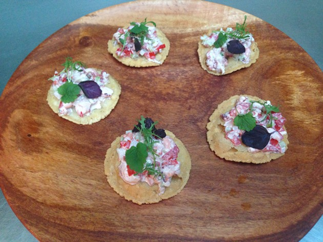 Octopus on tostada crisps - A.K. CARROLL