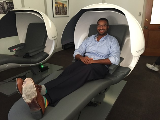 DozeSF's Brandon Smith reclines in one of his pods.