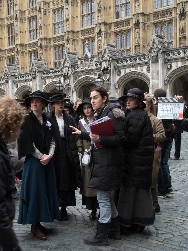 (L to R) Actress Anne-Marie Duff, actress Carey Mulligan, actress Helena Bonham Carter, director Sarah Gavron, and actress Romola Garai on the set of Suffragette. - STEFFAN HILL / FOCUS FEATURES