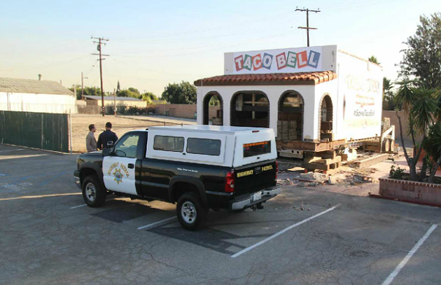 The original Taco Bell is filling out its change-of-address form with the help of a police escort. - TACO BELL