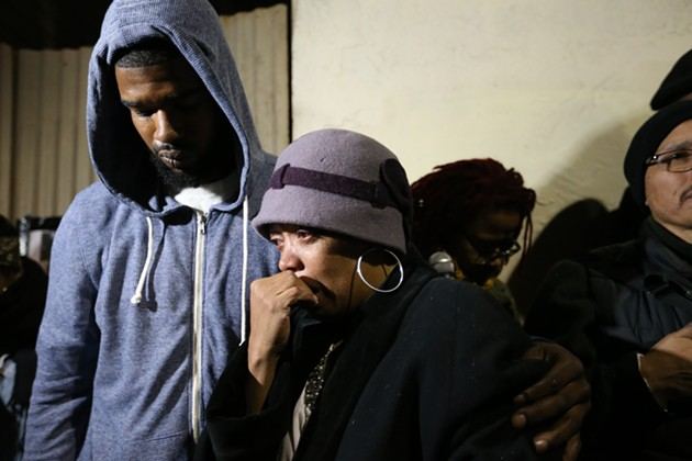 Jeff Stewart, left, and Gwendolyn Woods, the mother of Mario Woods, the man shot by police on Wednesday. - MIKE KOOZMIN/SF EXAMINER