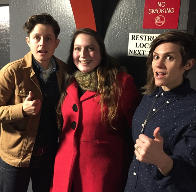 """Put Your Hands Together"" hosts Rhea Butcher and Cameron Esposito pose with a fan."